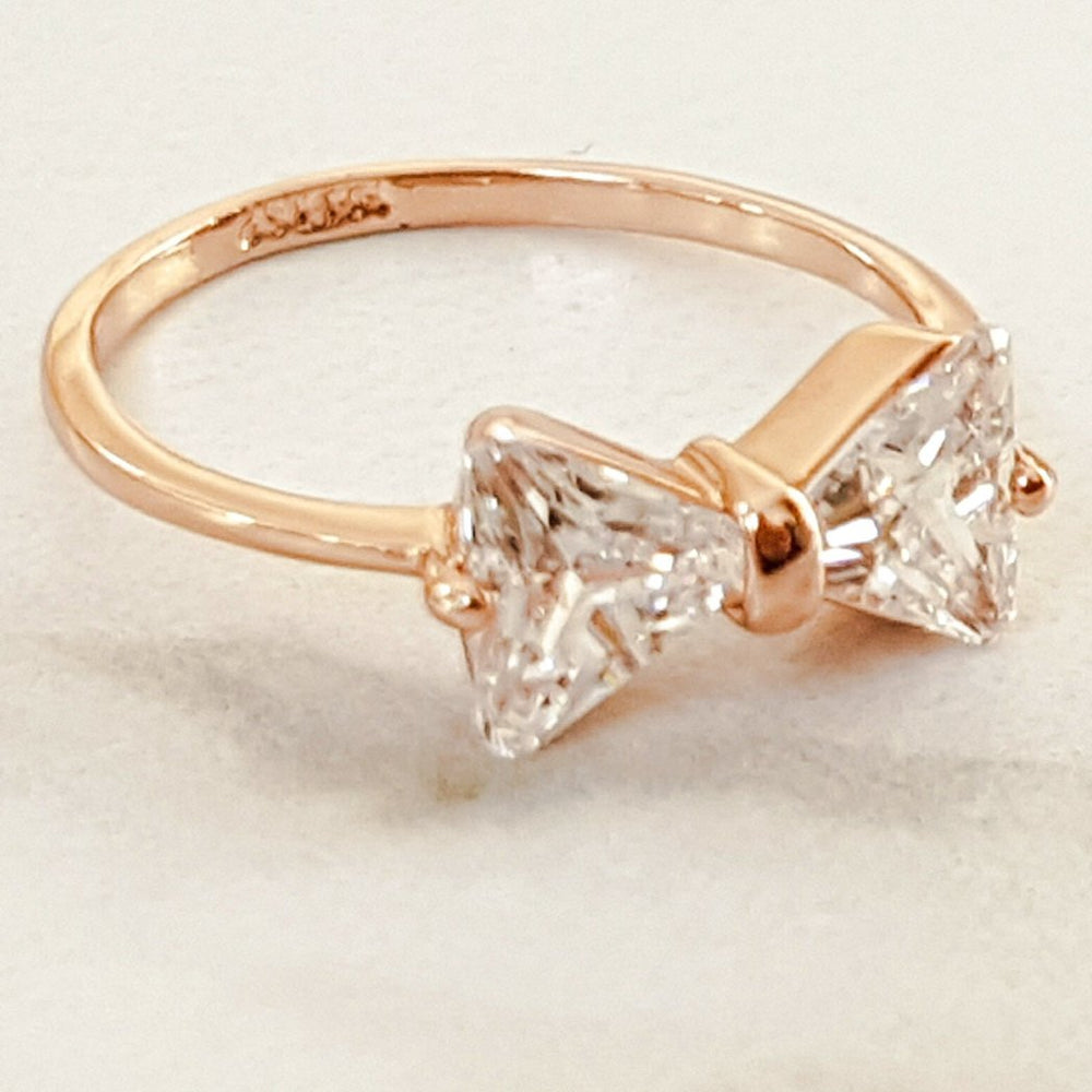 gold ring with rhinestone bow