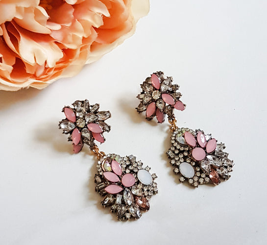 pink statement earrings