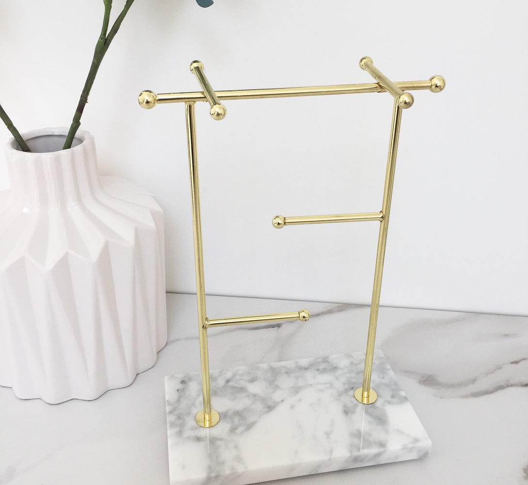 marble and gold tall necklace stand