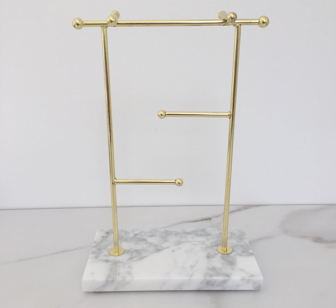 gold necklace and jewellery stand and ring holder