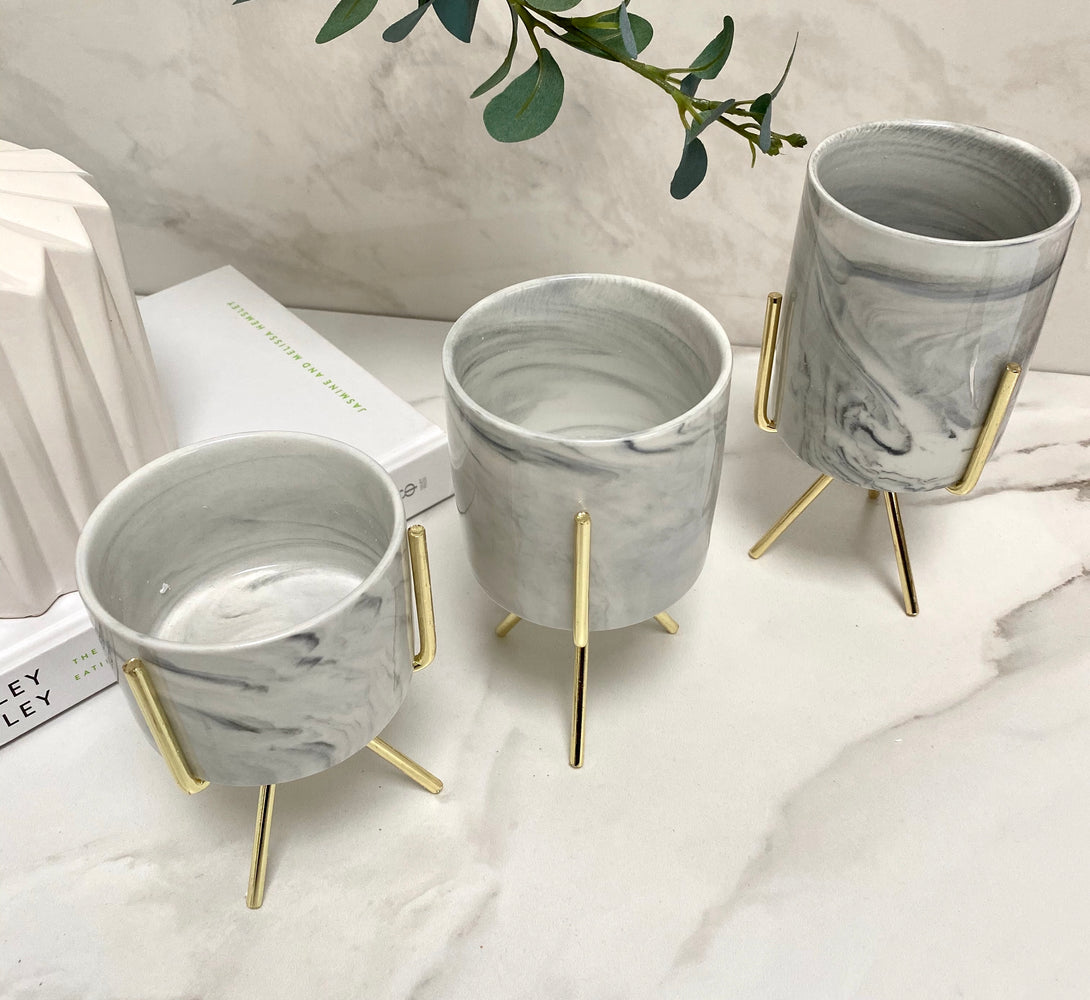 gold planters with marble base