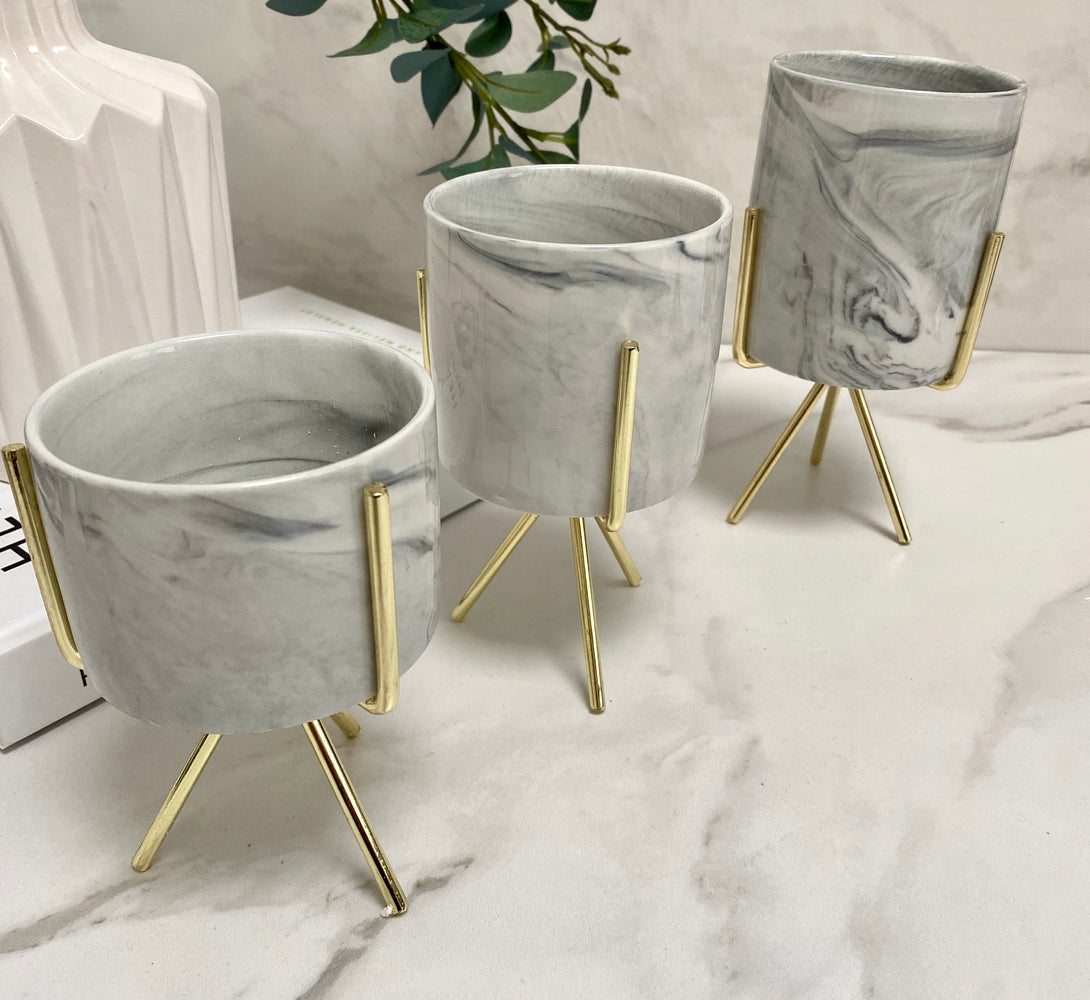 marble planter with gold stand
