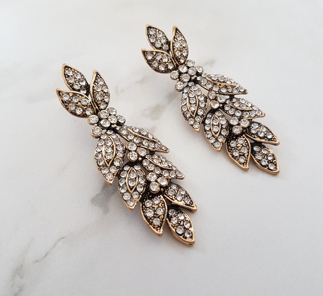 Gold rhinestone earrings in petal design