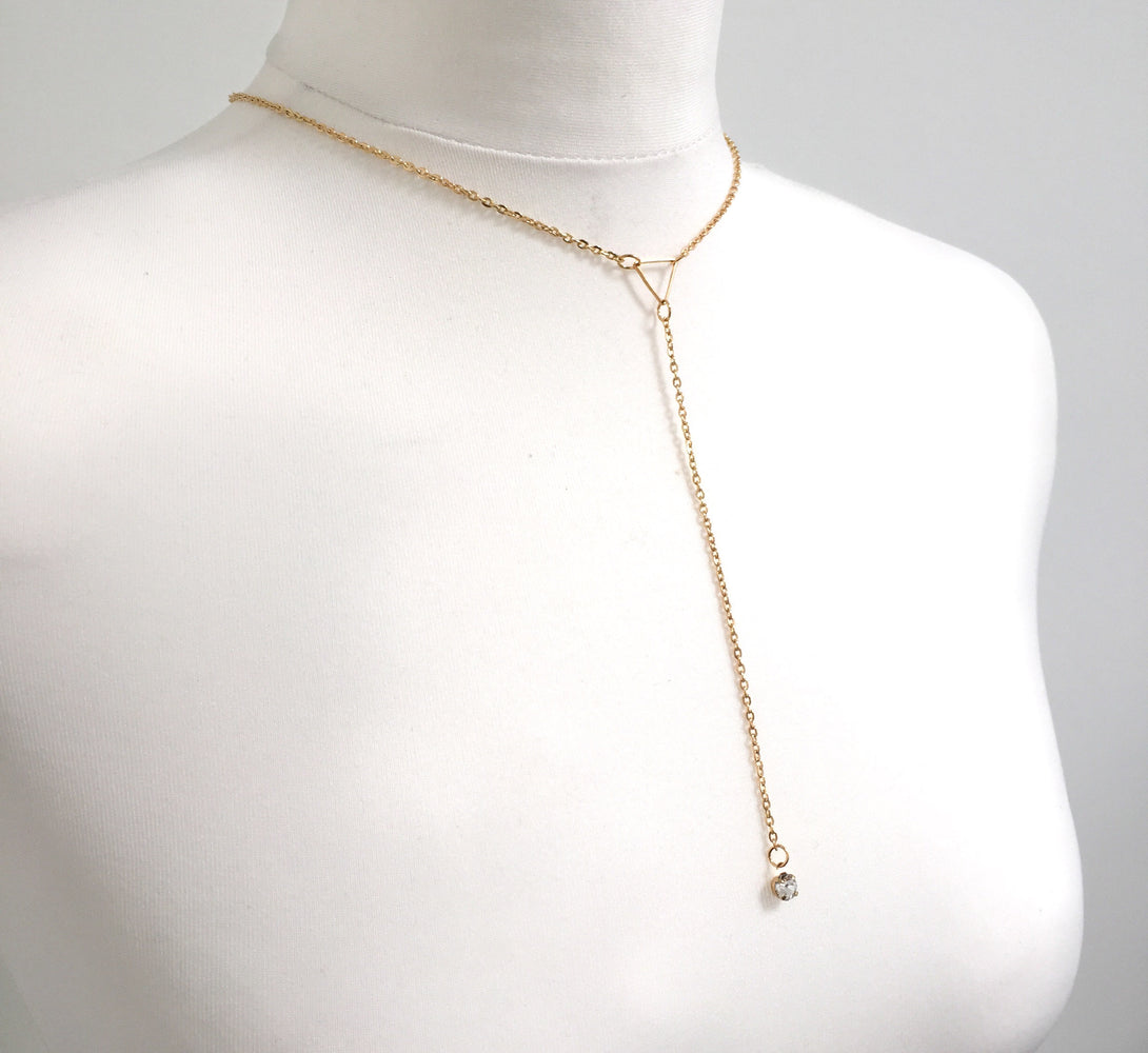 gold necklace with rhinestone drop