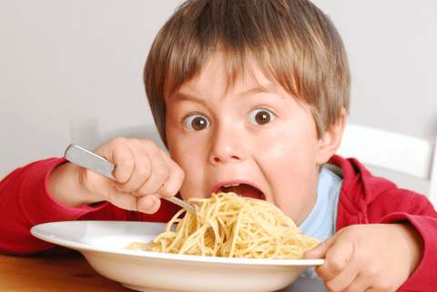toddler eating noodle