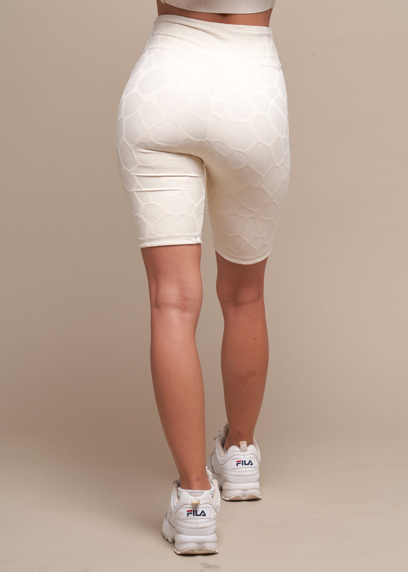 Give Your Self Space To Evolve Cream Biker Shorts