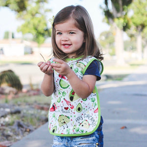 Taco Tuesday baby Apron rinses clean in the sink and makes mealtime fun for littles!