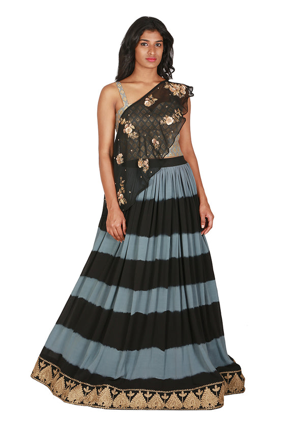 Striped lengha with brocade blouse and asymmetrical cape