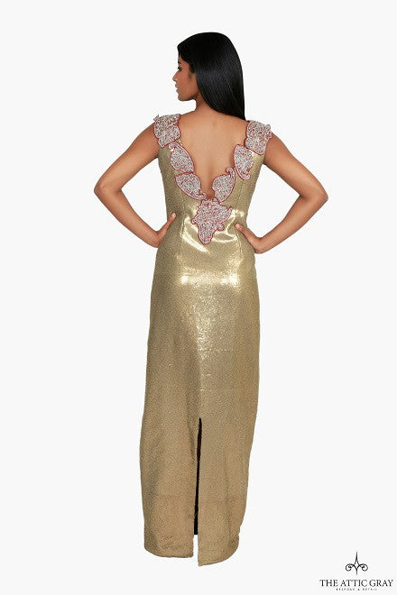 Gold sequin gown with deep V embroidered back