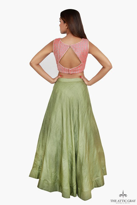 Red and gold cropped blouse with pista green tussar silk skirt