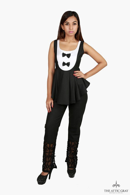 Black and white peplum blouse with black trousers.