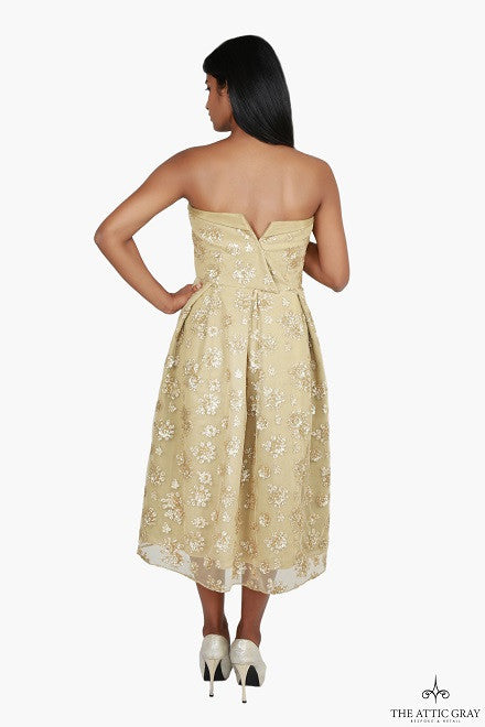 Gold strapless flared dress