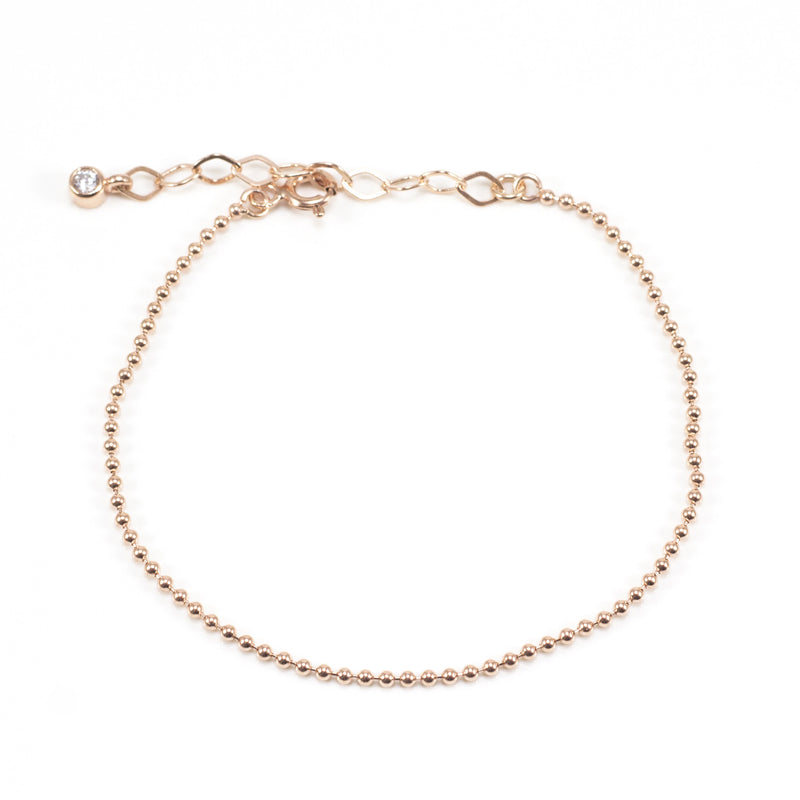 We love this super sweet Ball Chain Bracelet. Perfect for stacking.  Made of Rose Gold Plated Sterling Silver. Adjustable closure for a comfy fit.