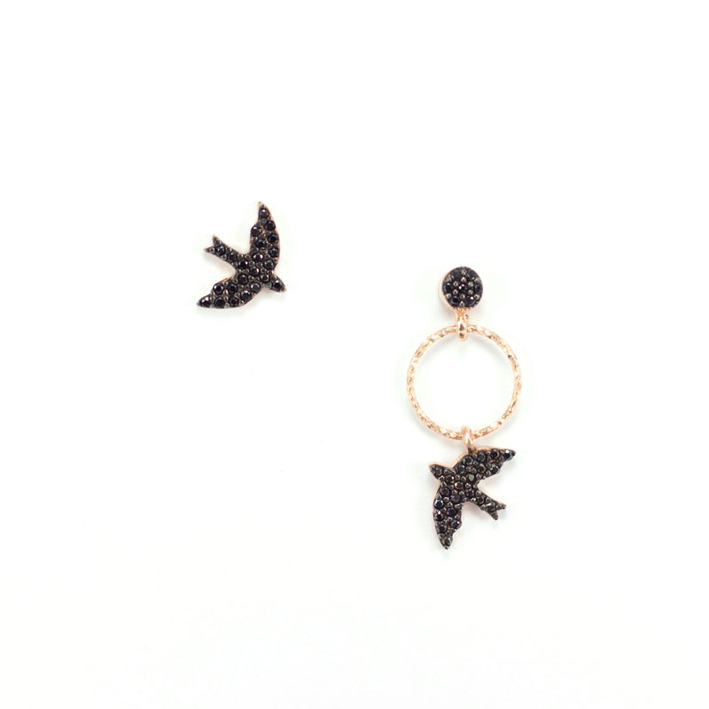 A small touch of the sky makes us feel as free as a bird. Wear both together or separate, our Bird Earring will ensure attention on your casual style.  This beauty is made of Rose Gold Plated Sterling Silver and black zirconiums.