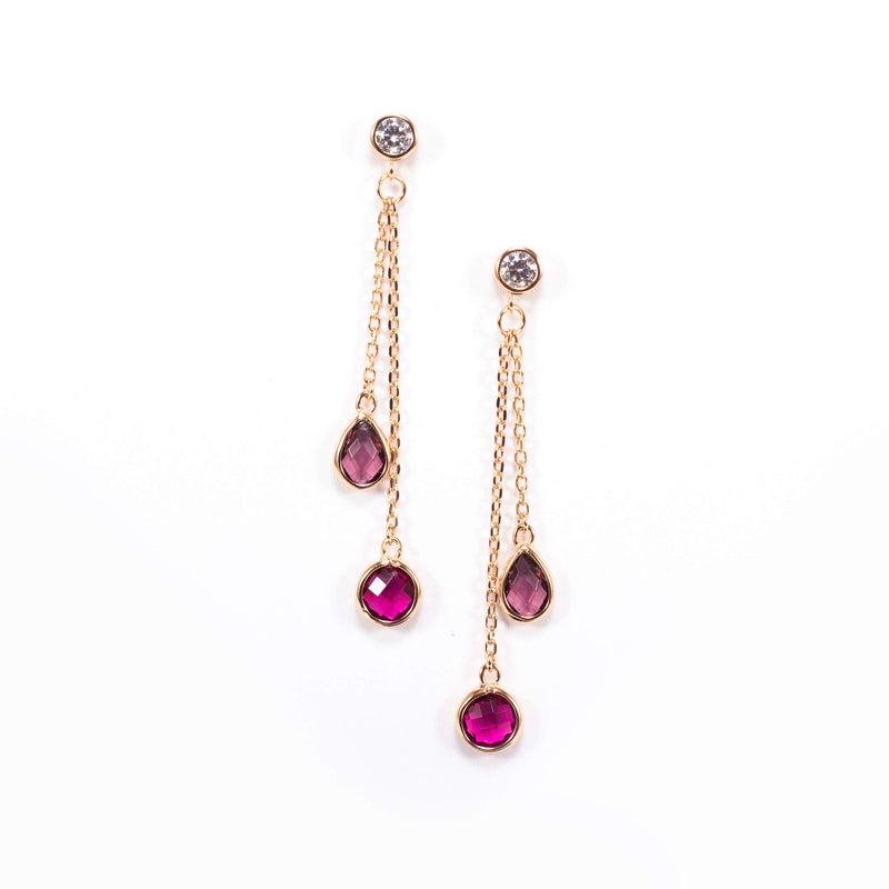 If you're searching for the perfect earring to wear on holiday, our stunning quartz earring is your go-to.  This lovely piece is made of rose gold plated sterling silver and cute fuchsia quartz.