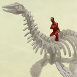 Tiny hand-painted person riding a plesiosaur Tinysaur skeleton