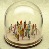 Tiny hand-painted people in a glass dome