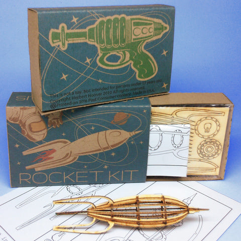 Miniature-sized Rocket Wood Model Kit with laser-cut parts, instructions, and retro packaging