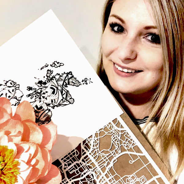 Michelle with prints, papercuts and paper flowers