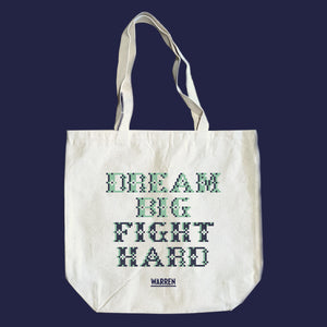 Natural canvas tots featuring a cross stitch style print of the phrase, Dream Big, Fight Hard. (4407646486637)