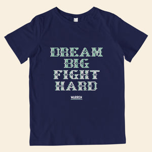 Navy youth t-shirt featuring cross stitch style print of the phrase, Dream Big, Fight Hard.