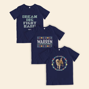 Three navy youth t-shirts featuring cross stitch style prints of Bailey, the phrase, Dream Big, Fight Hard, and the classic Warren logo.