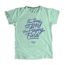 "Load image into Gallery viewer, Liberty green unisex t-shirt with ""It's Time To Level The Playing Field"" in purple."