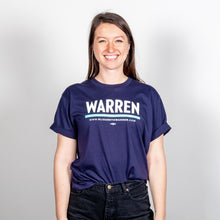 Load image into Gallery viewer, Warren Unisex T-Shirt in Navy and Green on model.