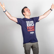 Load image into Gallery viewer, Dream Big, Fight Hard Unisex Navy T-shirt with White and Red Text. On model with arms spread wide to display the vastness of the big structural change we want. (1518922596461)
