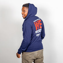 Load image into Gallery viewer, We Persist Hoodie in navy, back view with hood up on model.