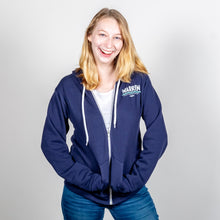 Load image into Gallery viewer, We Persist Navy Hoodie Front View On Model.