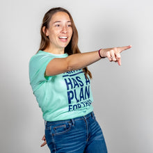 Load image into Gallery viewer, Liberty Green Warren Has A Plan For That Unisex T-Shirt tucked in on model, pointing enthusiastically.  (4052827177069)