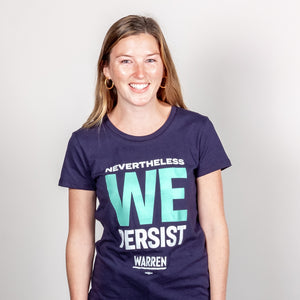 We Persist Platinum Navy Fitted T-Shirt with Liberty Green and White text. On smiling model. (1518922465389)
