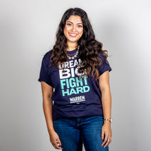 Load image into Gallery viewer, Dream Big, Fight Hard Unisex Navy T-shirt with White and Liberty Green Text. On smiling model. (1518922596461)