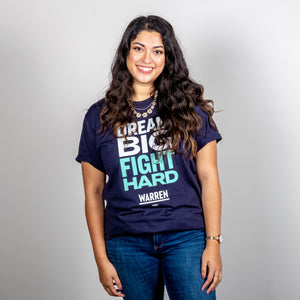 Dream Big, Fight Hard Unisex Navy T-shirt with White and Liberty Green Text. On smiling model. (1518922596461)