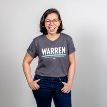Load image into Gallery viewer, Warren Minimalist Unisex Asphalt T-shirt with White and Liberty green text. On smiling model with hands in pockets. (1519734849645)