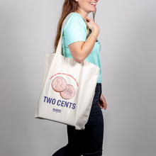 "Load image into Gallery viewer, ""Two Cents"" Tote on shoulder of walking model."