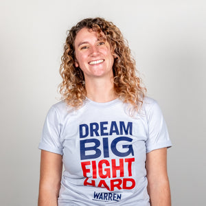 Dream Big, Fight Hard Unisex Grey T-shirt with Navy and Red print on model.