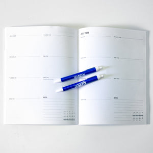 Planner opened to weekly planning calendar.