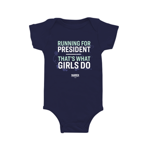 "Navy onesie with the words ""Running for president, that's what girls do,"" in white and liberty green type."