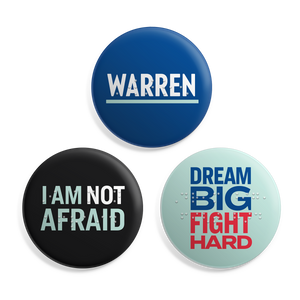 "Braille Button 3-Pack. Three buttons with the phrases: Warren, I Am Not Afraid, Dream Big Fight Hard with Braille overlay on each button. Buttons are 2.5"" in diameter."