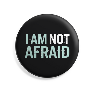 "I Am Not Afraid 2.5"" button with Braille overlay. Black button with liberty green and white text."