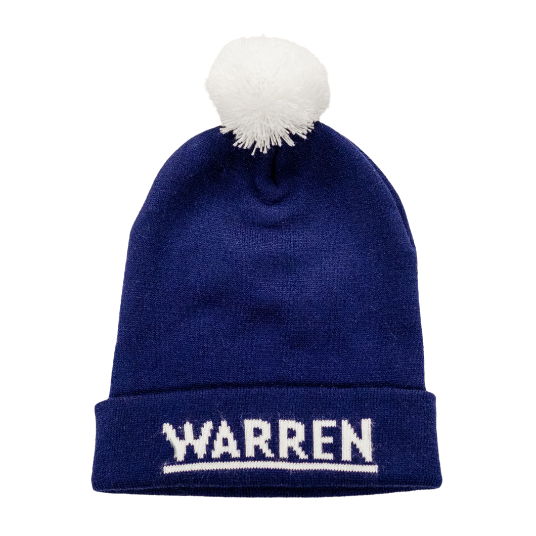 Navy Knit Hat with white pompom and the Warren logo on the cuff of the hat.