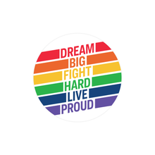 "Load image into Gallery viewer, Round 2.25"" sticker with a white background and the phrase ""Dream big fight hard live proud"" with each word stacked and in a different color of the rainbow with color bands expanding to the right and the left of each word."