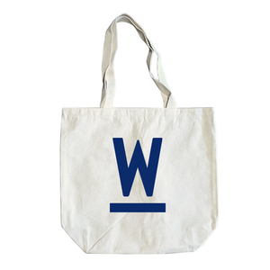 "Natural canvas tote with navy Warren ""W"" logo."