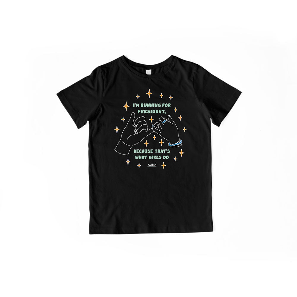 Youth-sized black T-Shirt with pinky promise hands and the words, I'm running for president, because that's what girls do, in liberty green lettering.  (4171471126637)