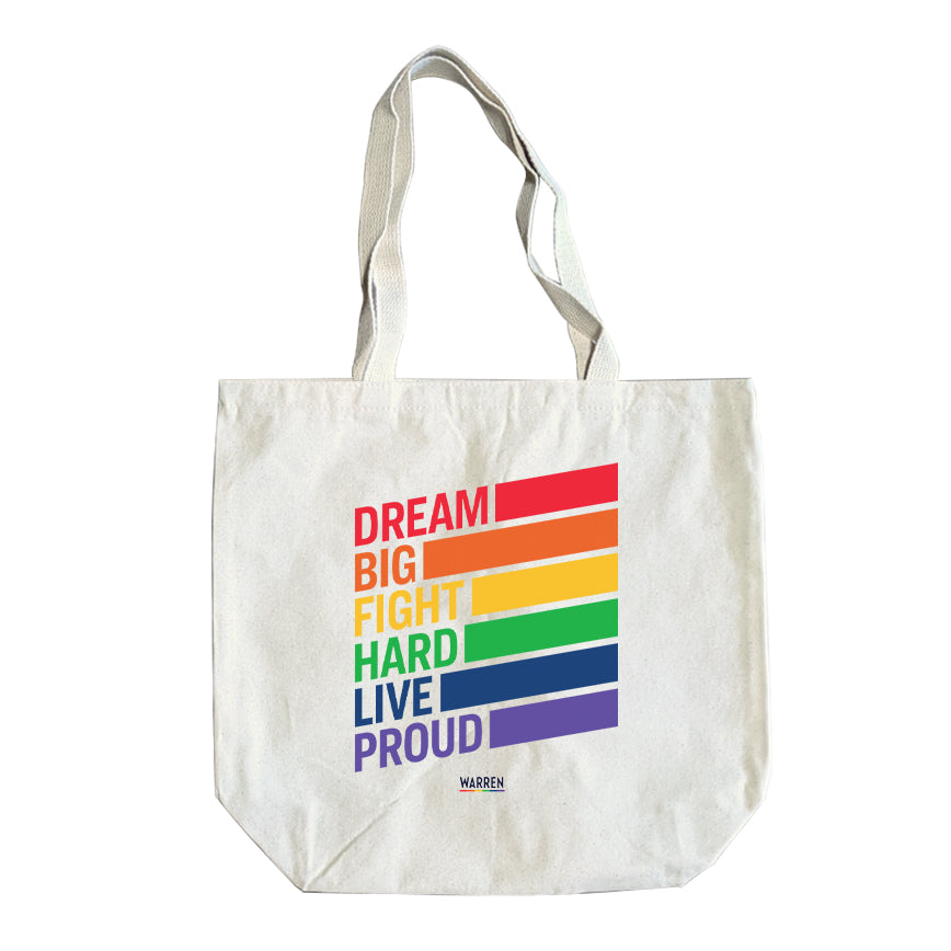 Natural colored tote with the words, dream big fight hard live proud, stacked at left in each color of the rainbow with a band of color following each word.