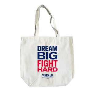 "Natural colored tote with the words, dream big fight hard, stacked. ""Dream big"" is written in blue and ""fight hard"" is written in red. (1518881407085)"