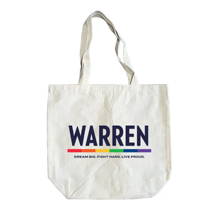 "Natural colored tote with the WARREN logo, WARREN is in navy and the line beneath it is rainbow. Beneath the logo is a line of text that says ""dream big. fight hard. live proud""."