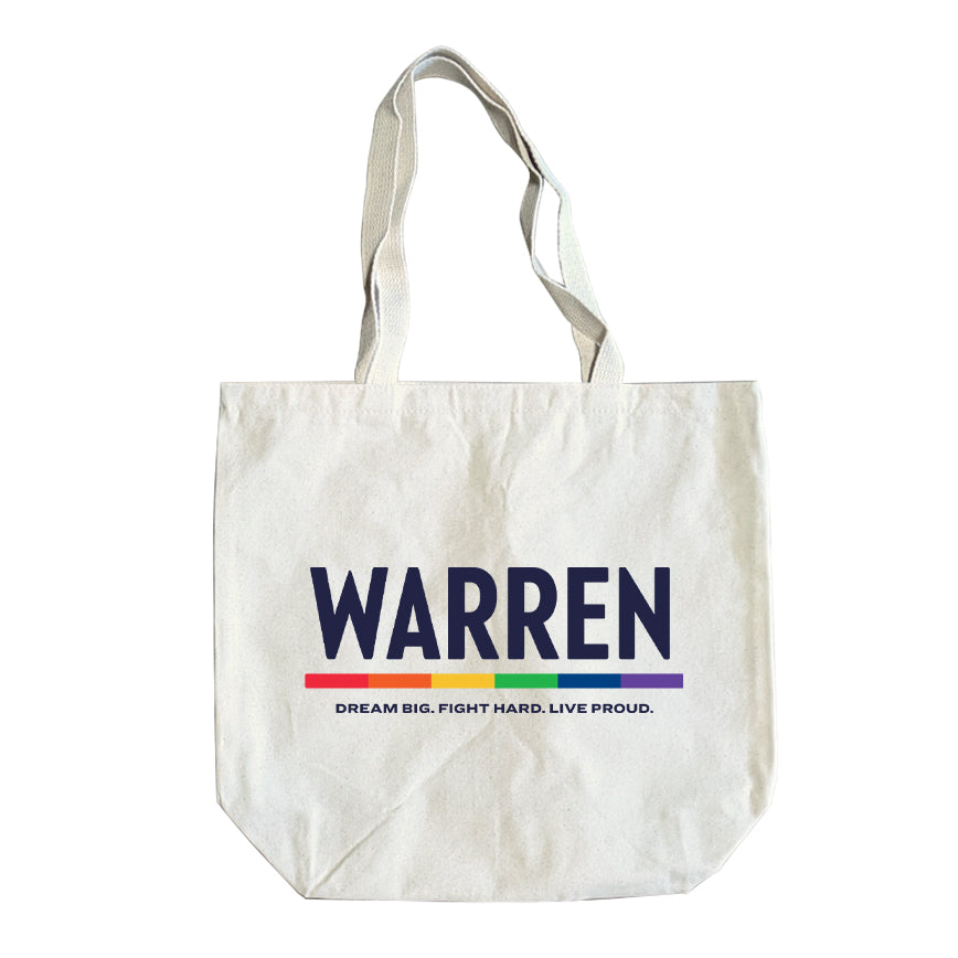 Natural colored tote with the WARREN logo, WARREN is in navy and the line beneath it is rainbow. Beneath the logo is a line of text that says
